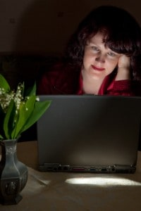 Woman in front of laptop screen